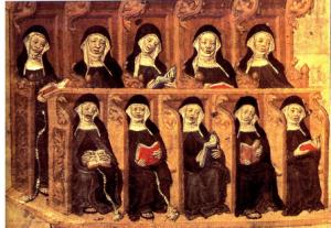 Monjas medievales cantando en el coro